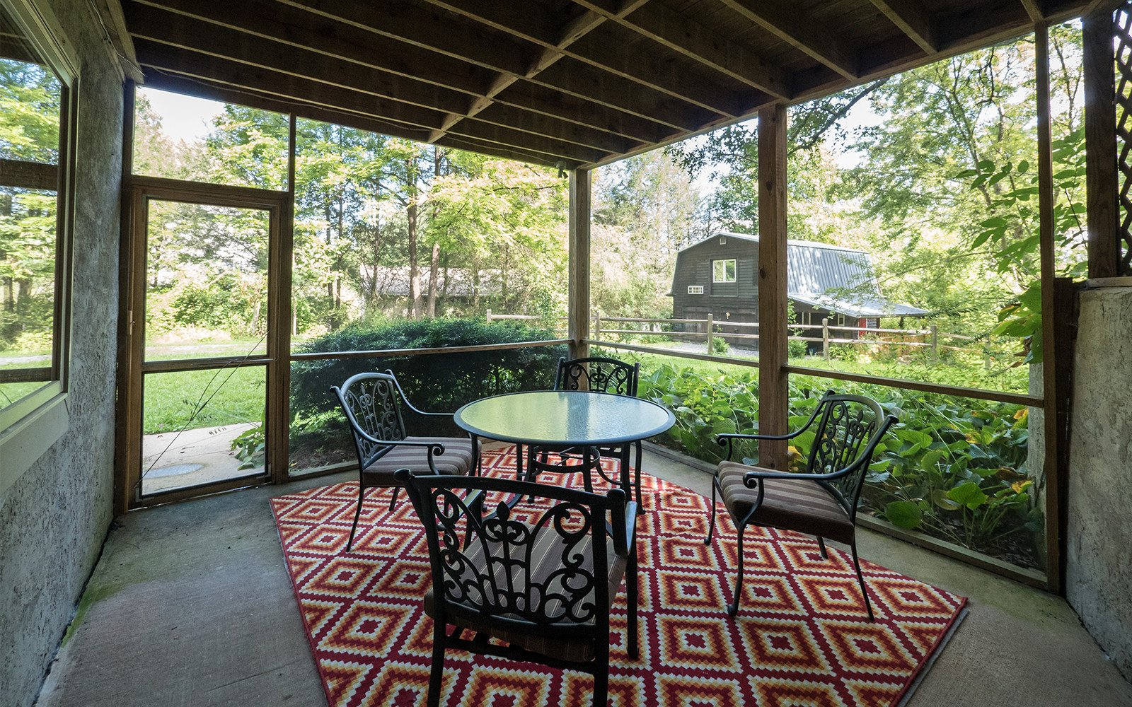 Downstairs-screen-porch-at-Hilt-St-house